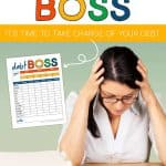 Lady with hands on her head and elbows on a desk with the words: Debt Boss, It's Time To Take Charge Of Your Debt