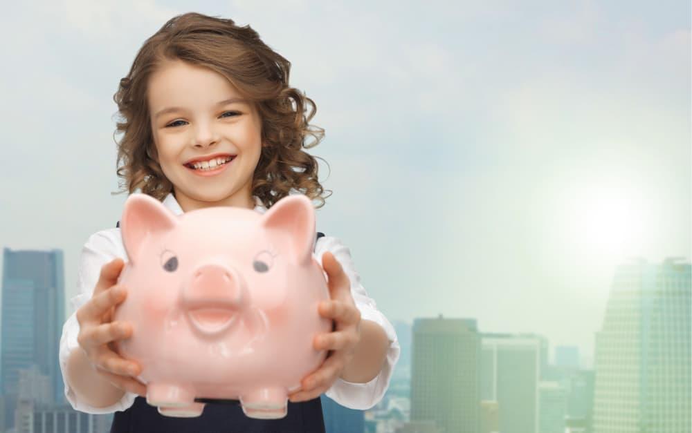 Girl and Piggy Bank