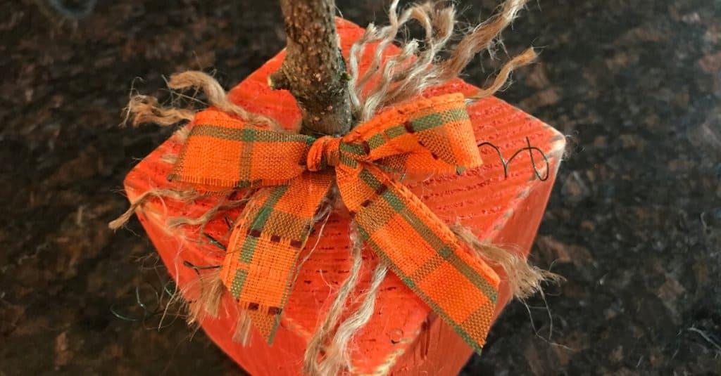 4 x 4 pumpkin with a festive bow.