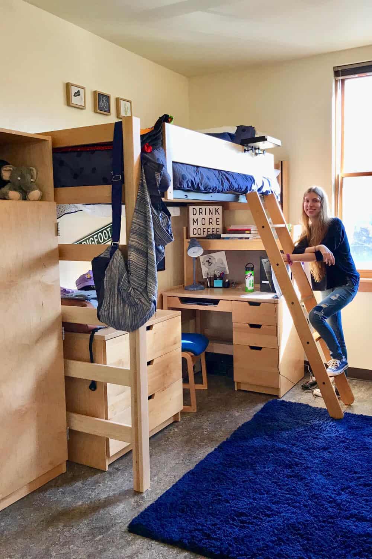 Setting up her dorm room freshman year.