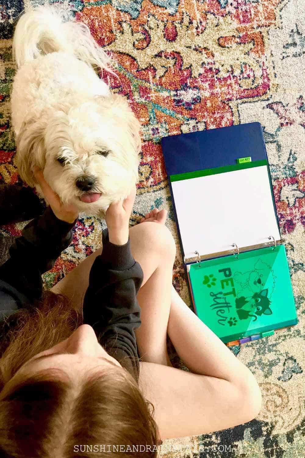 Pet sitter with dog and Pet Binder.