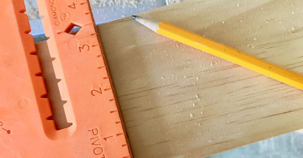 A square helps to draw a straight line on wood, for cutting.