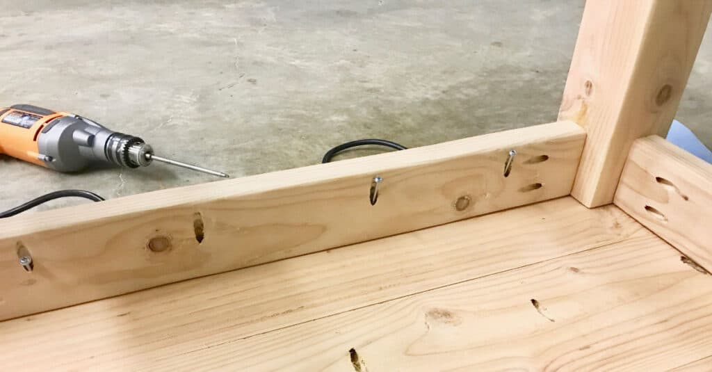 Attaching the table base to the table top.