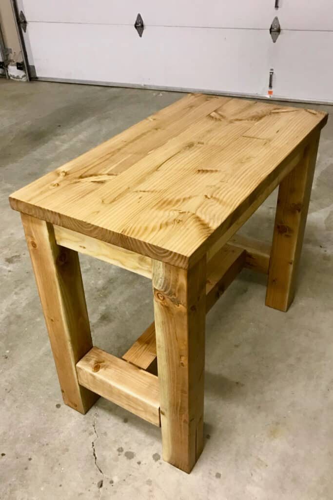 Staining the counter height table with homemade stain.