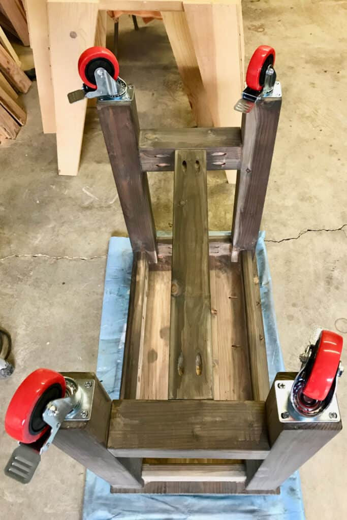 Wheels attached to table legs.