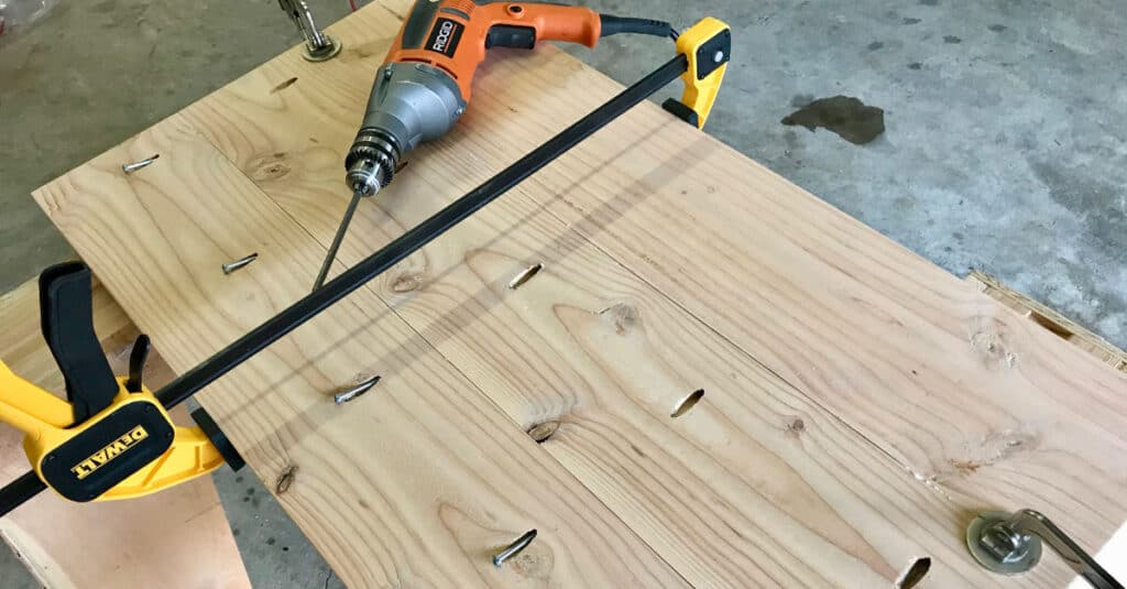 Using a trigger clamp to hold table top boards together.