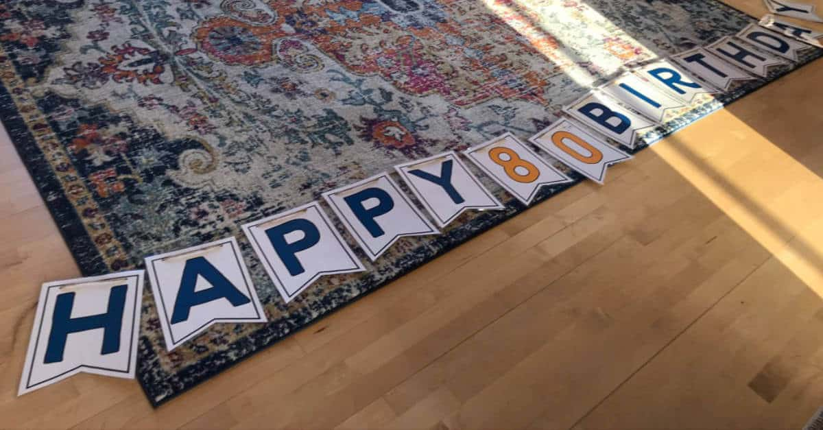 Happy Birthday Banner laid out on the floor, ready to be hung!
