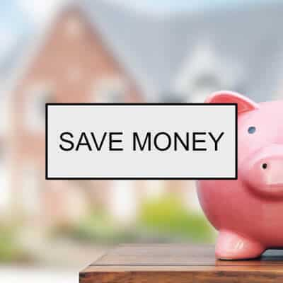 Piggy Bank with house in background and the words: Save Money