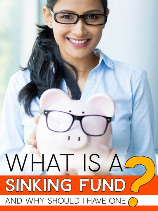 Girl holding piggy bank with the words: What Is A Sinking Fund?