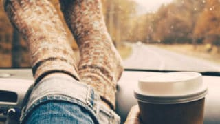 Lady holding coffee with the words: Gift Ideas For The Coffee Fanatic