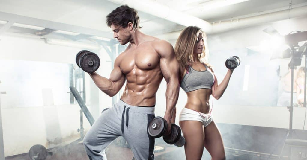 Couple working out at the gym.