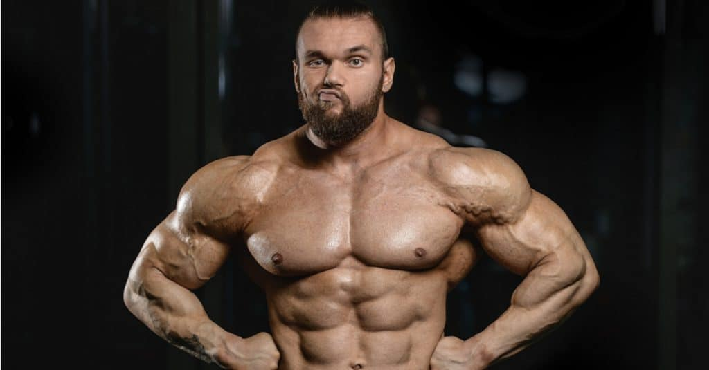 Muscle guy with a funny look on his face.