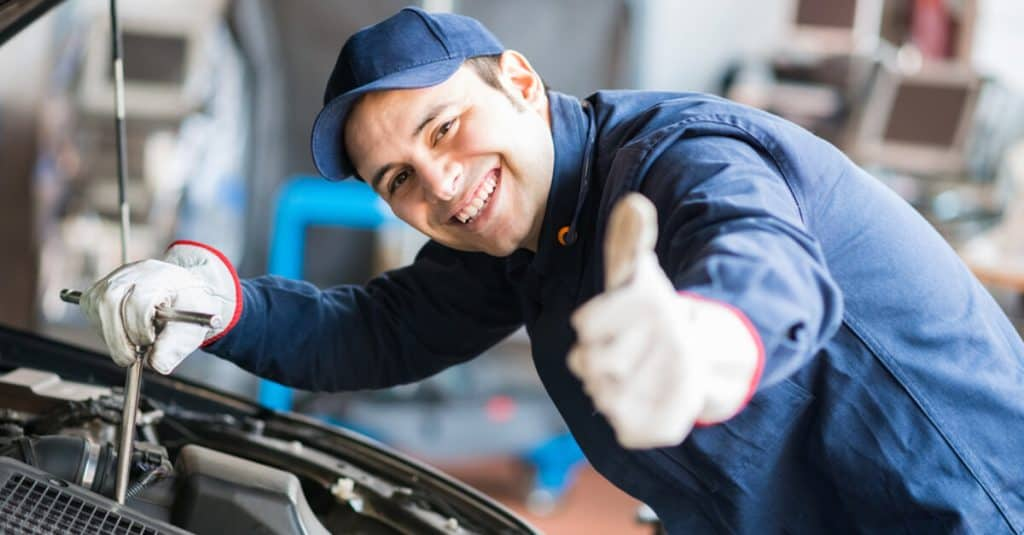 Mechanic giving a thumbs up.