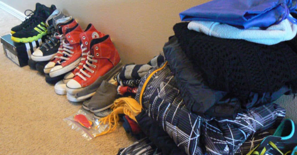Clearing the coat closet to organize it.