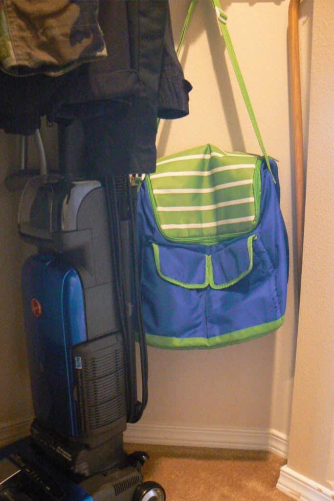 Vacuum cleaner and cooler bag, in the coat closet.