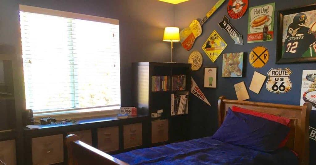 Tween boy's room with a wall of memorabilia.