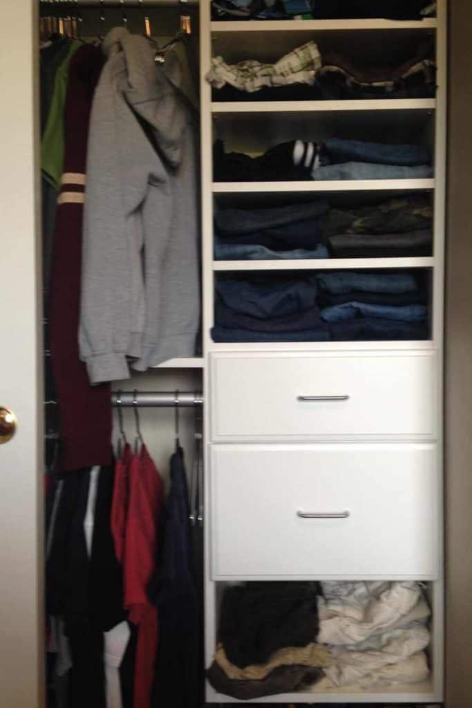 Tween boy's closet full of clothes.