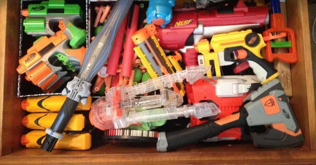 Nerf guns stored in an under the bed drawer.