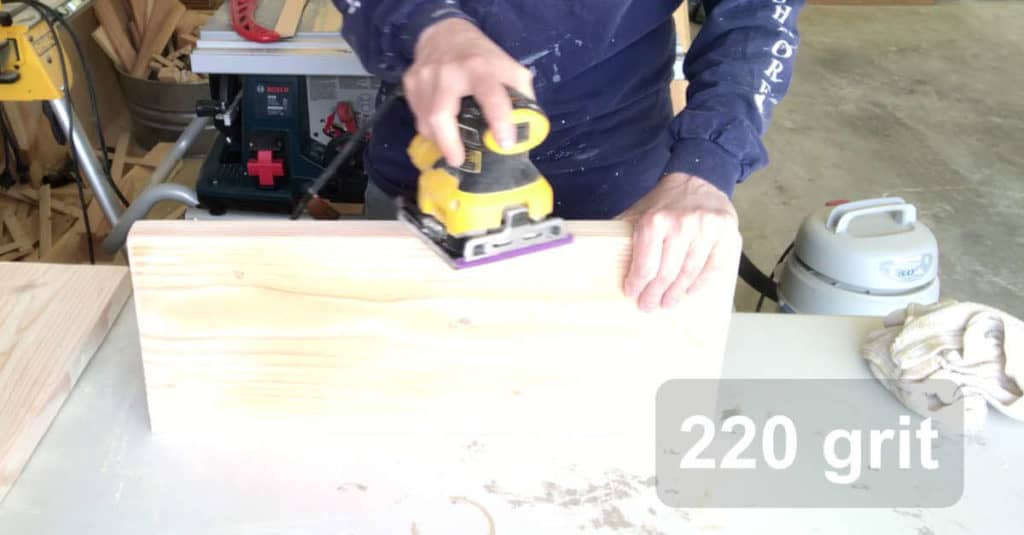 Sanding bench top with 220 grit sandpaper.