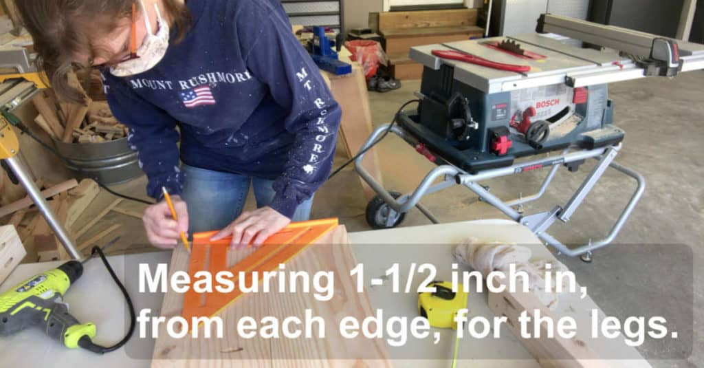 Measuring in 1-1/2 inch from each edge to find the placement for bench legs.