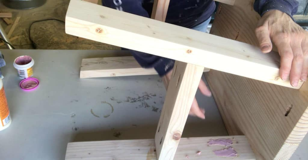 Filling pocket holes with pocket hole plugs and wood fill.