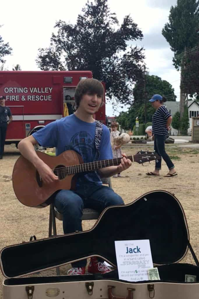 Teenager busking at a local farmer's market.