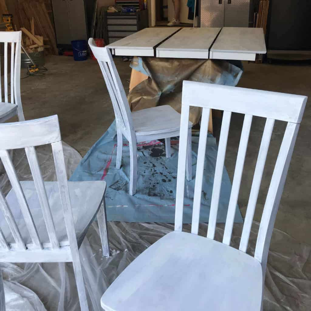 Table and chairs with primer painted on.