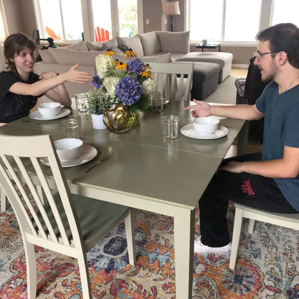 Justine and Colton sitting at the finished kitchen table!