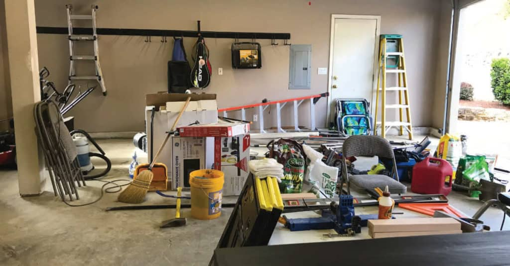Messy garage that needs to be organized.