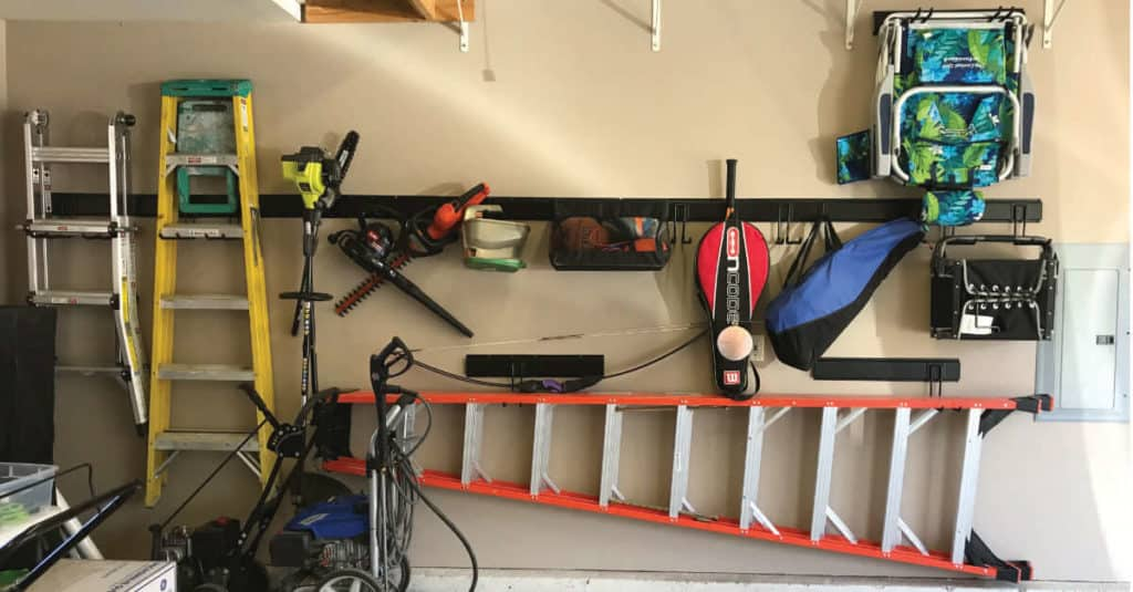 Using vertical wall space to organize the garage.
