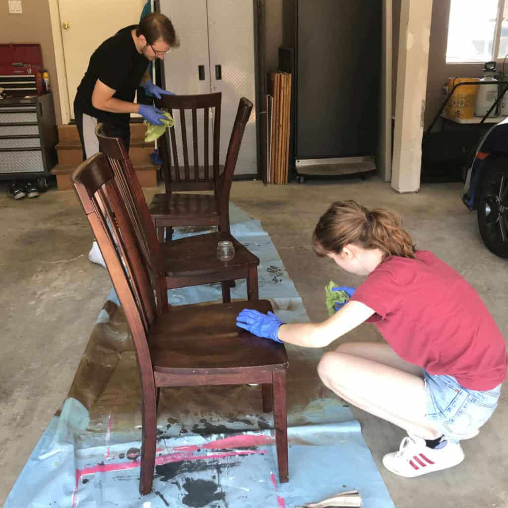 Wiping down chairs with Krud Kutter Gloss-Off.