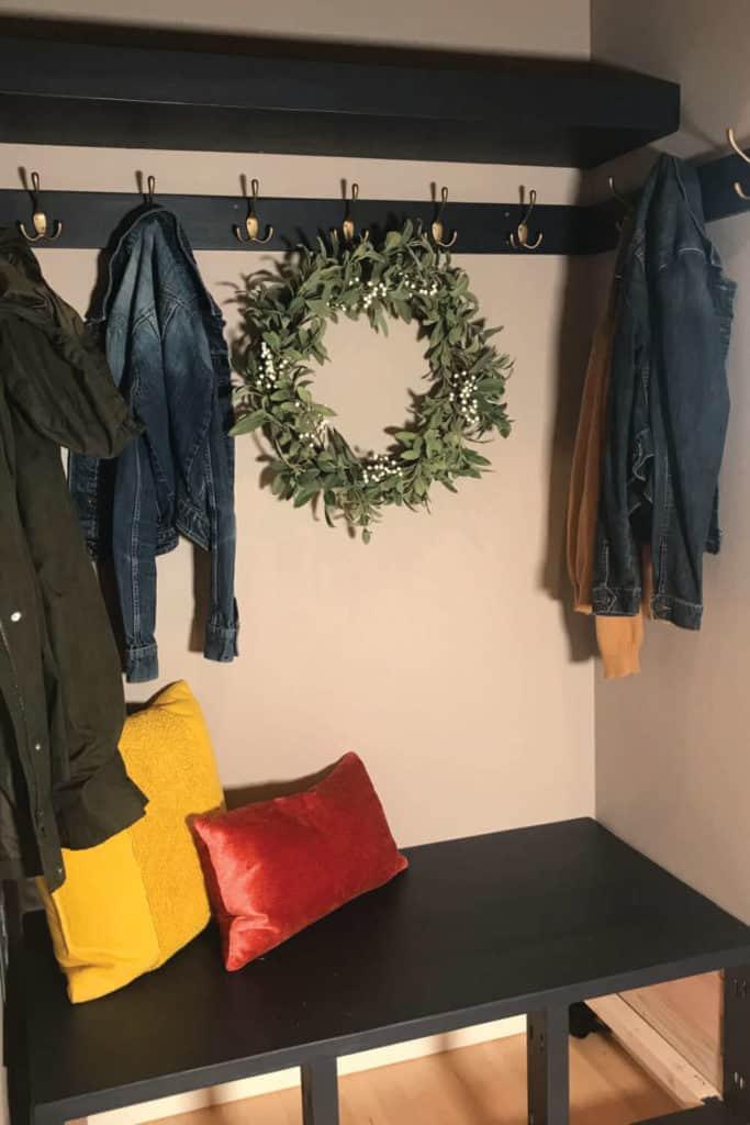 Coat closet converted into a mudroom nook.